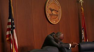 Outgoing St. Louis County Executive Charlie Dooley takes a moment for himself before the beginning of a county council meeting filled with Ferguson protesters on Tuesday, Sept. 16, 2014